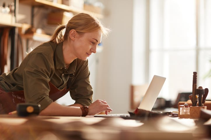woman looking at her laptop