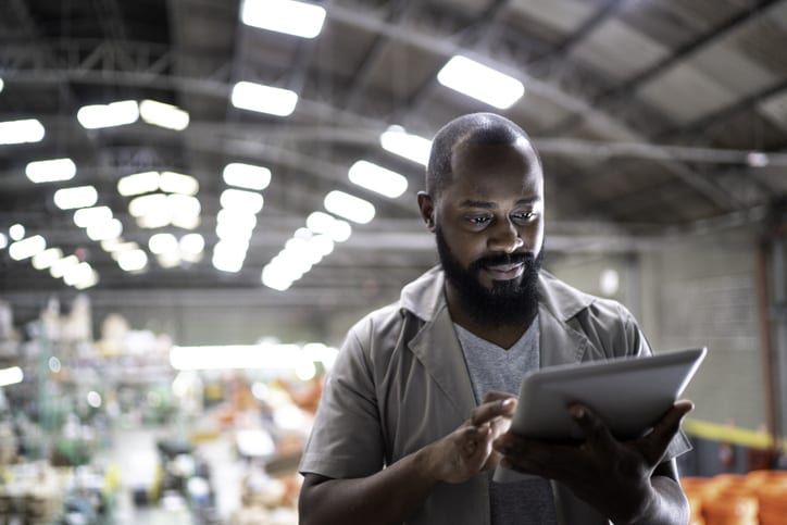 warehouse manager looking at tablet